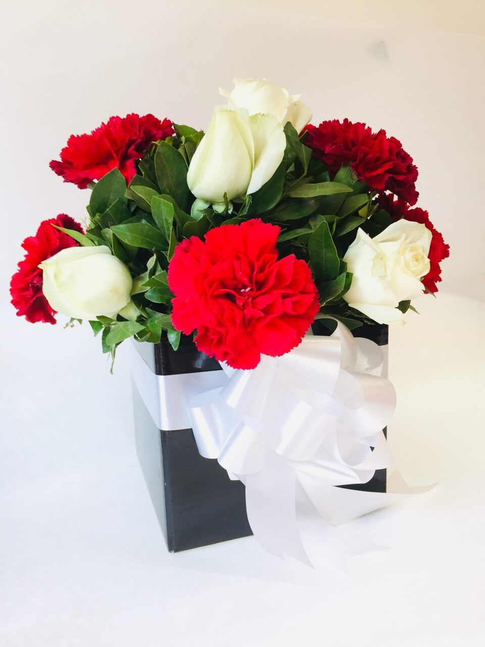 Carnations and Roses in Black Box