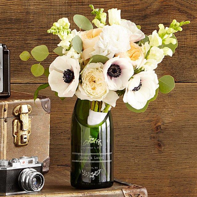 flowers in champagne bottles vase