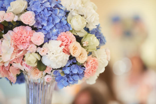 Wedding bouquets at dinner tables